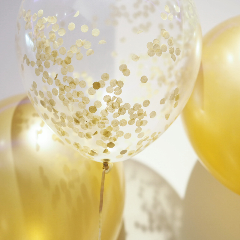 Gold confetti filled balloons from a blogging event