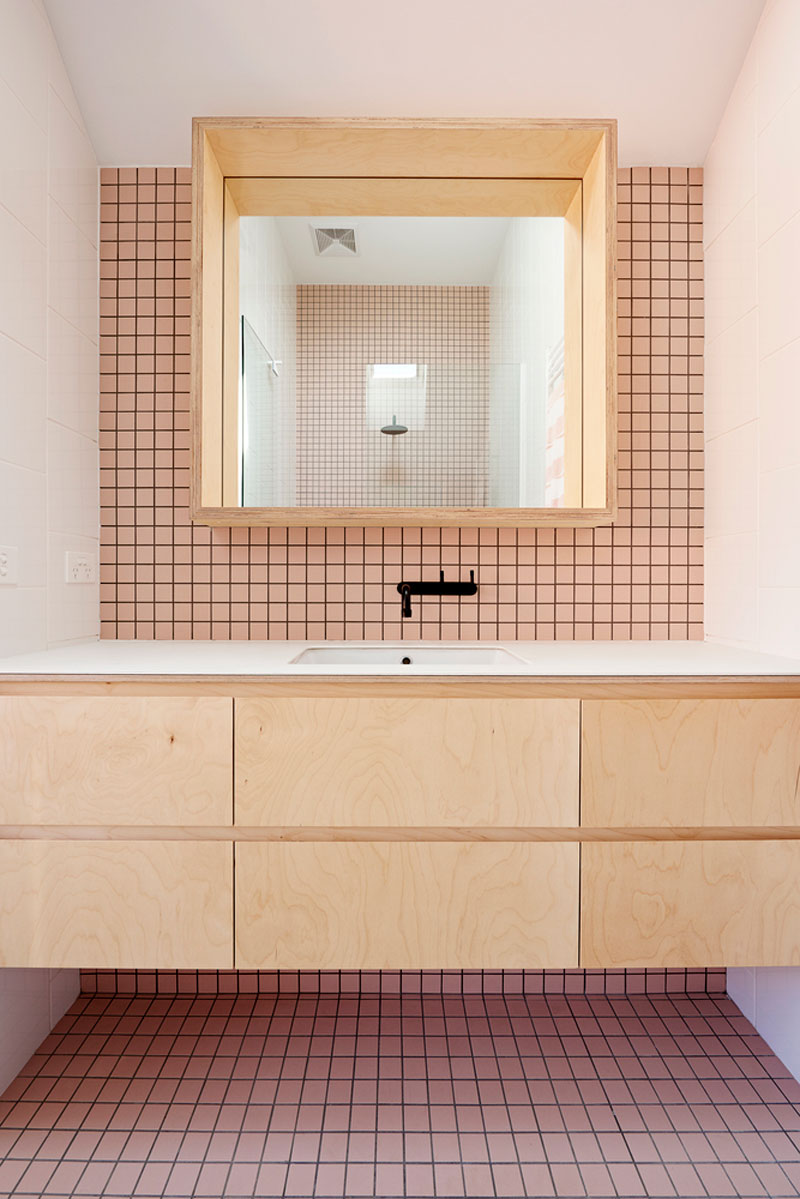 Pink tiled bathroom with black grouting