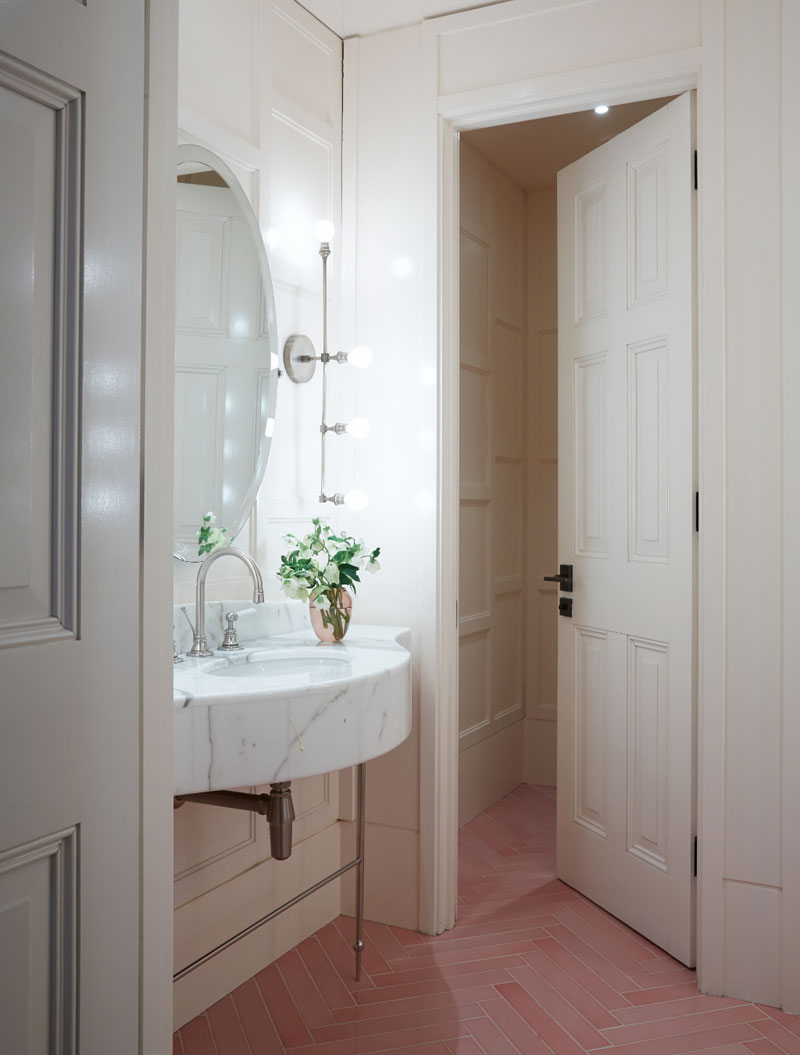 Pink herringbone tiled floor in bathroom