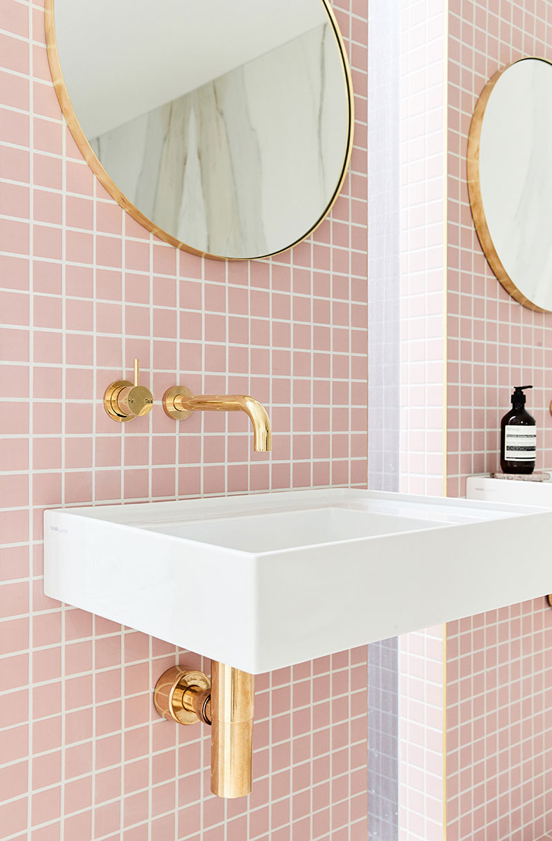 Pink tiled bathroom with brass fixtures
