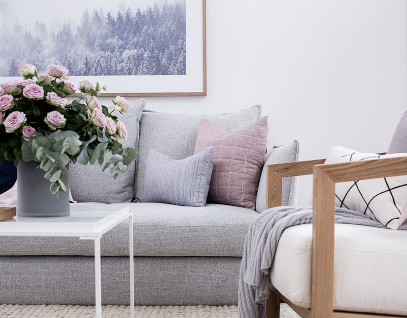 Styling the sofa with cushions and throws