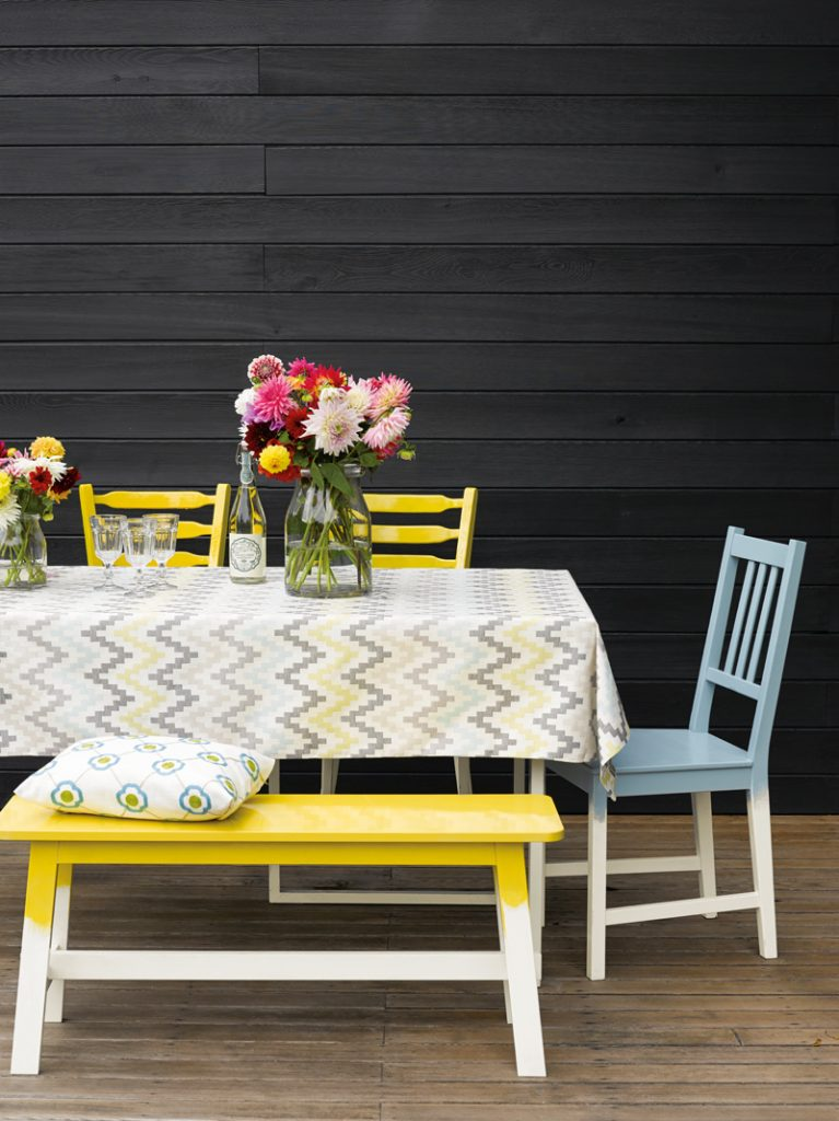 Outdoor dining area with painted furniture