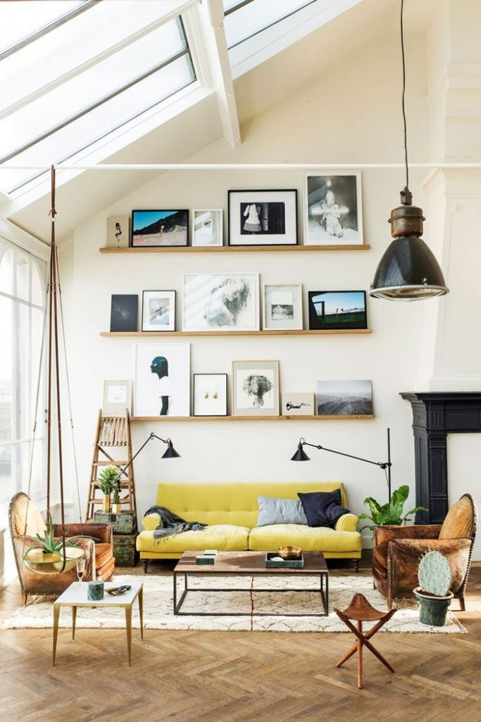 eclectic living room with yellow sofa and gallery wall