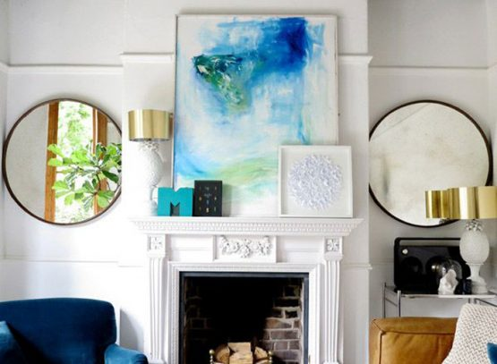 eclectic living room with abstract art work and styled mantle