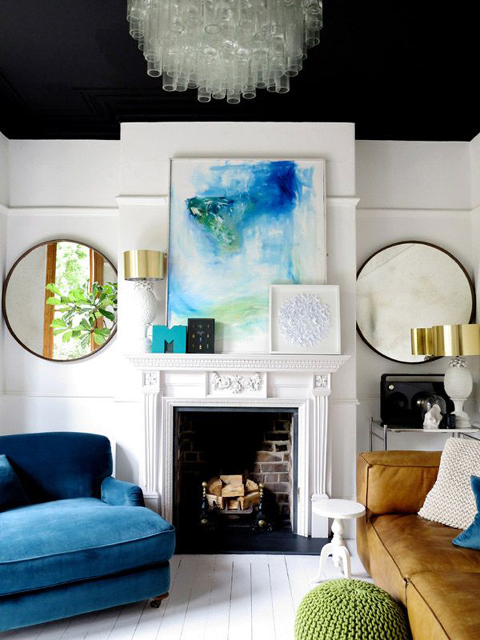 Eclectic living room with abstract art work and a styled mantle piece