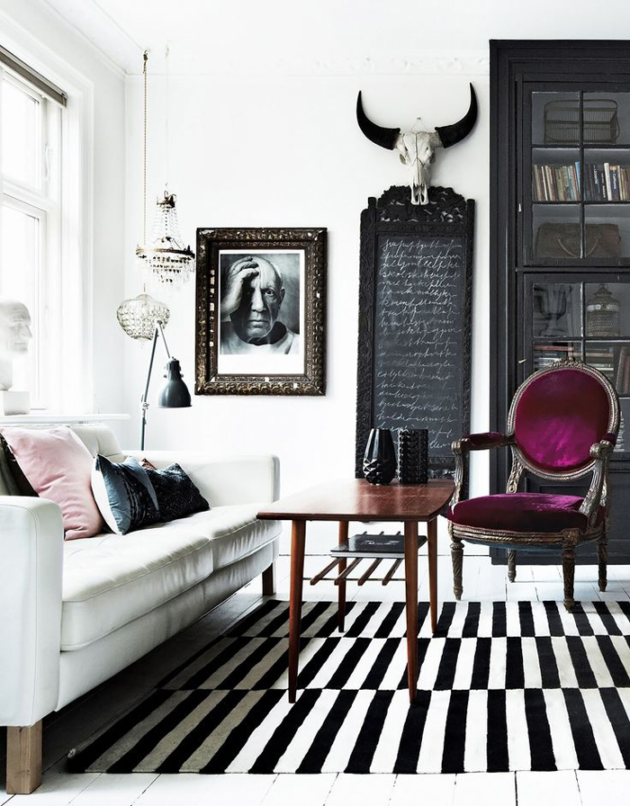 Eclectic Scandinavian living room with striped rug