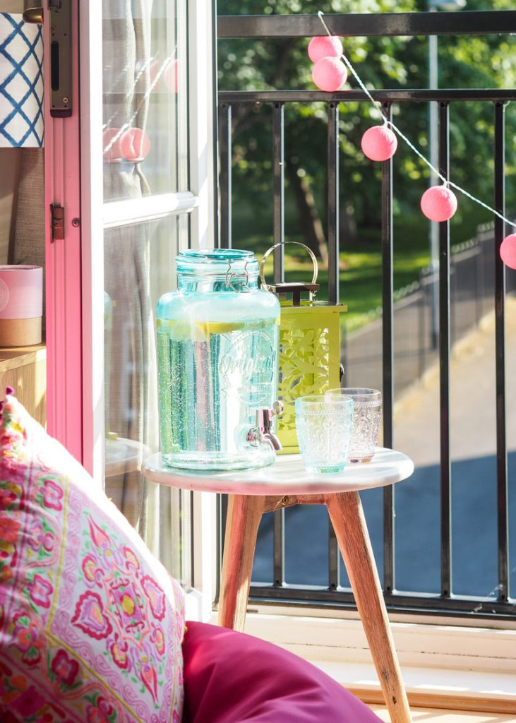 Drinks dispenser and lantern on balcony