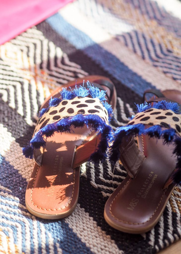 Leopard print sandals on the rug