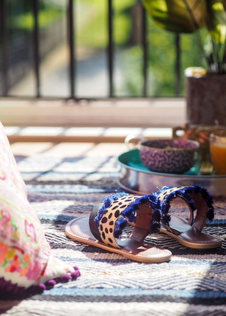 Leopard print summer sandals on the rug