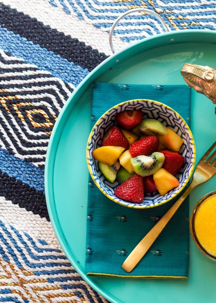 Fruit salad on turquoise breakfast tray