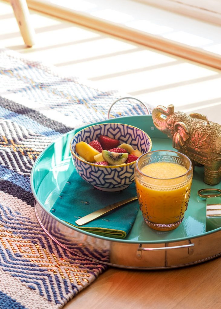 Teal breakfast tray with fruit salad