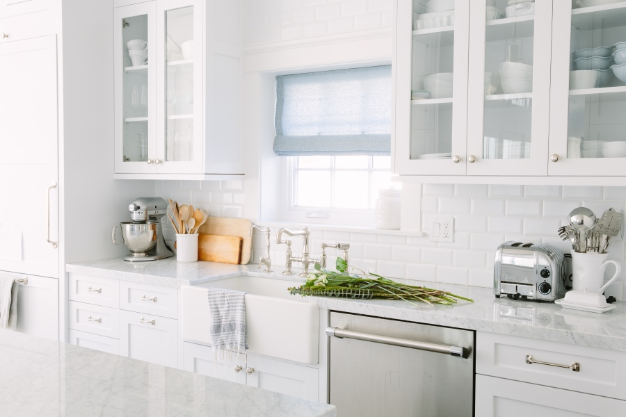 White kitchen with subway tiles and farmhouse sink