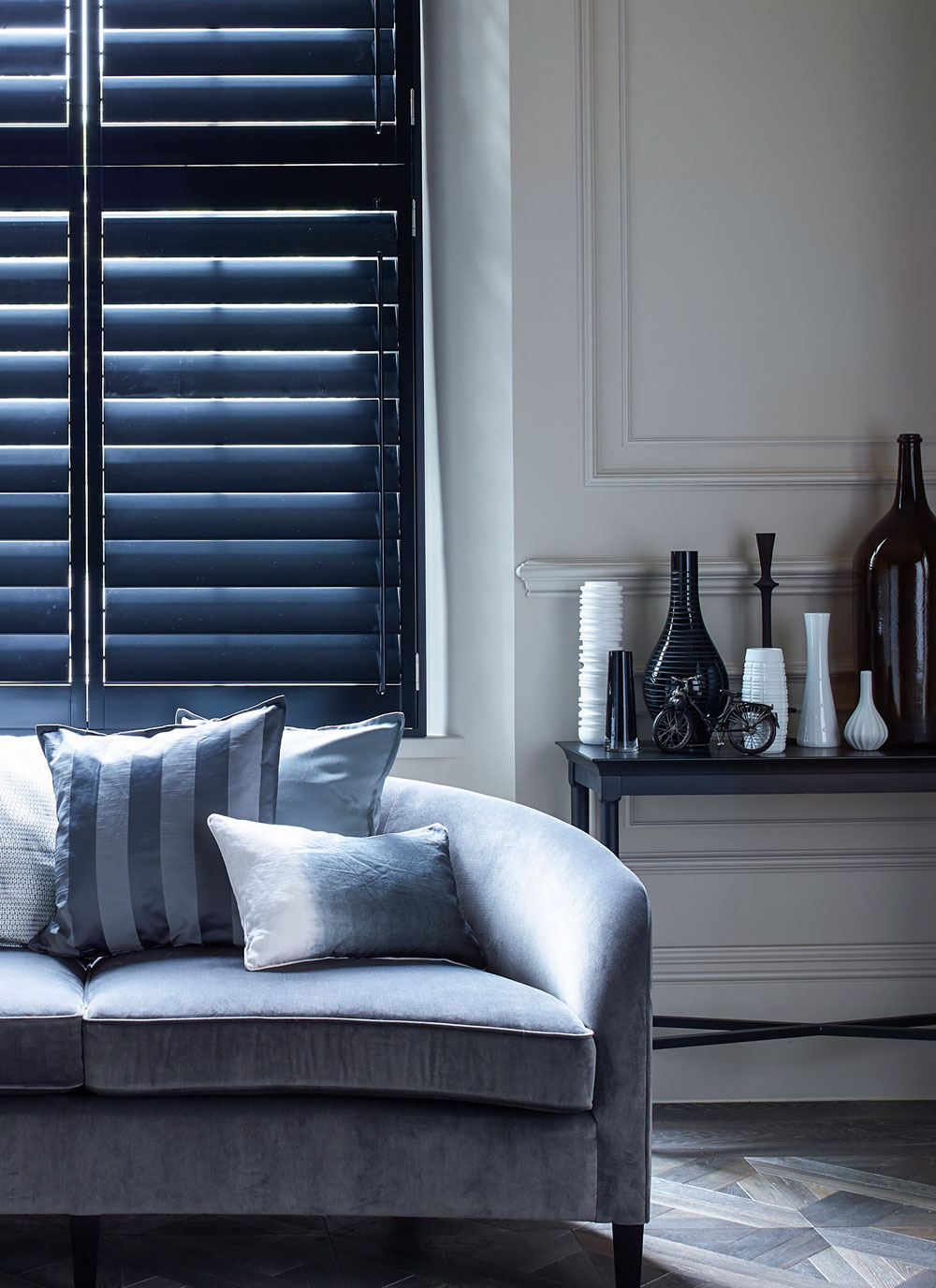 Black shutters in a dark and dramatic living room