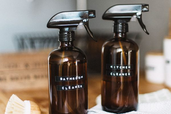 Homemade cleaning products in brown glass spray bottles