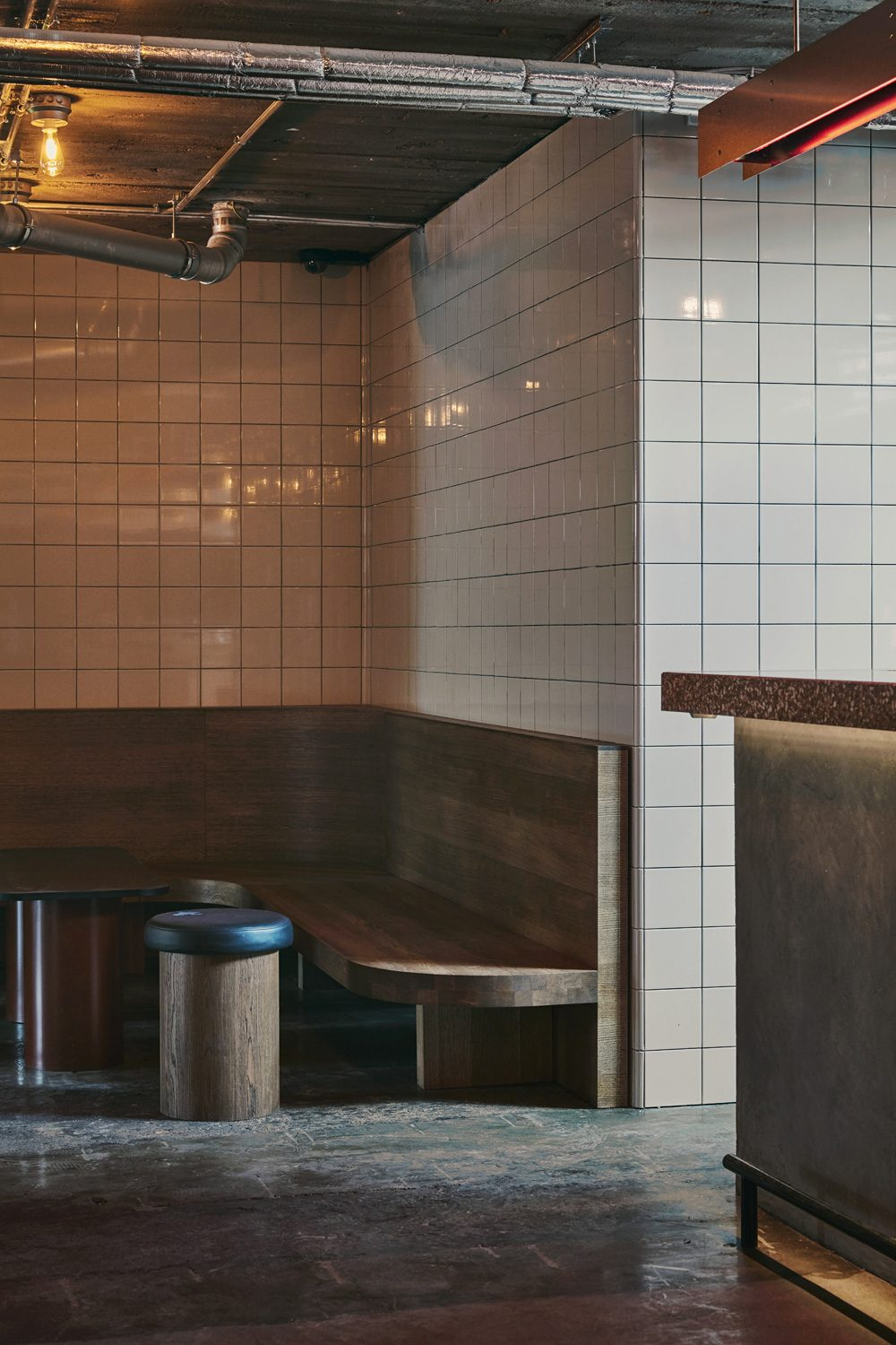 Interior of Post Bar in Finland with pink square tiles and grey grouting